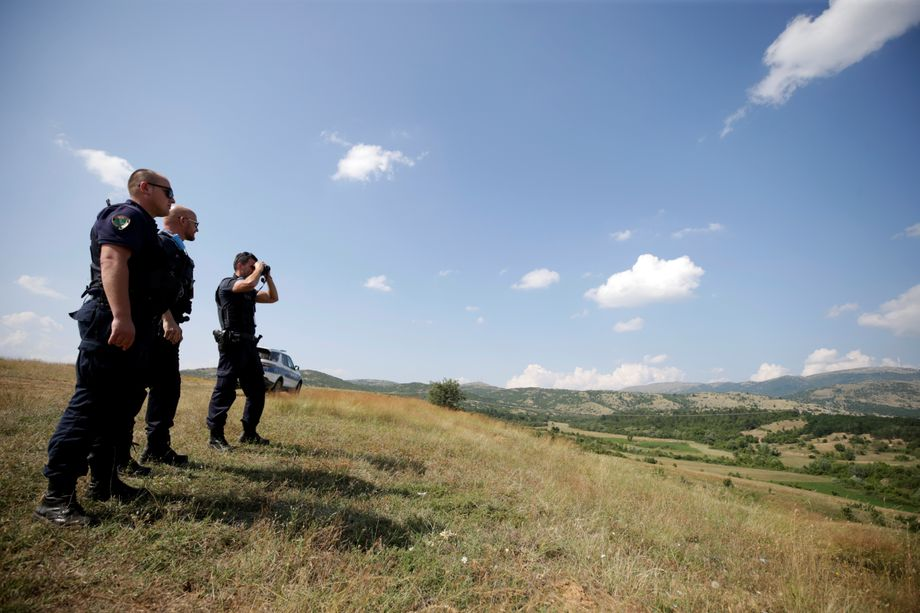 """A member of Frontex patrols with his colleagues near the border between Albania and Greece: a """"Potemkin reserve."""""""