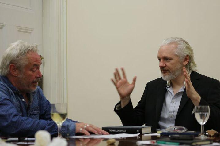 Julian Assange (right) speaks to SPIEGEL journalist Michael Sontheimer inside the Ecuadorian Embassy in London.