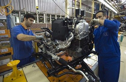 Employees work at Iran Khodro's joint venture assembly plant with France's Renault near Tehran. Germany is to accuse France and the US of hypocrisy over sanctions against Iran.