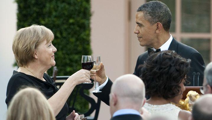 Besuch im Weißen Haus: Die Merkels und die Obamas