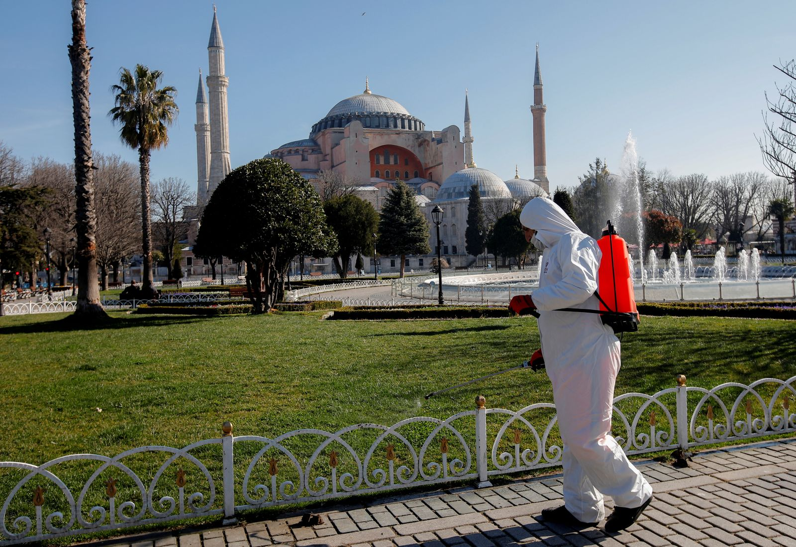 A worker in protective suit disinfects Sultanahmet square in response to the spread of coronavirus disease (COVID-19) in Istanbul