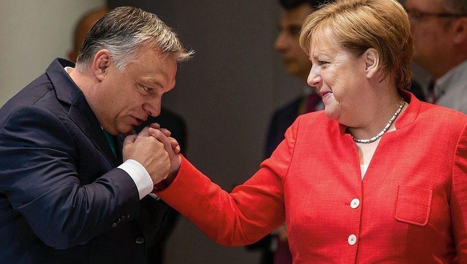 Regierungschefs Orbán, Merkel