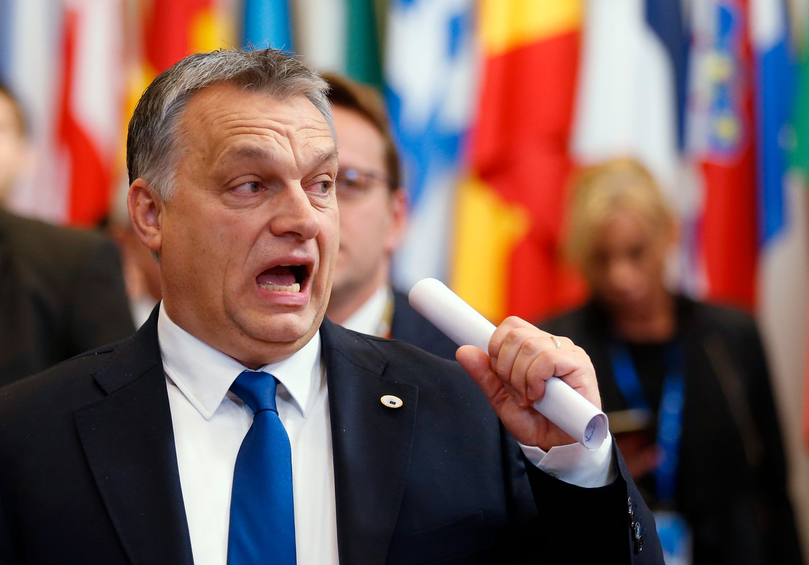 Hungary's PM Orban reacts as he leaves a EU leaders summit in Brussels