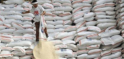 The Philippines will take delivery of 500,000 tons of rice in May to address its shortage. But the price has been bid up by speculators.