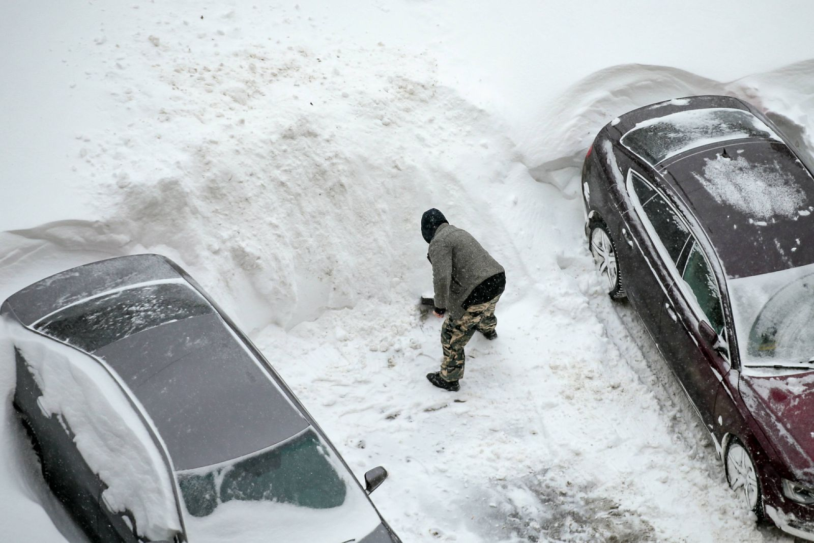 Heavy snowfall in Moscow, Russia. Car in traffic heavy snowfall DmitryxGolubovich