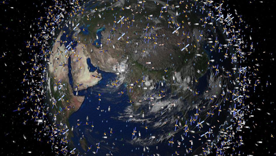 """Weltraummüll neben intakten Satelliten (Computersimulation): """"Das Problem sind die nicht mehr steuerbaren, ausrangierten Teile"""""""