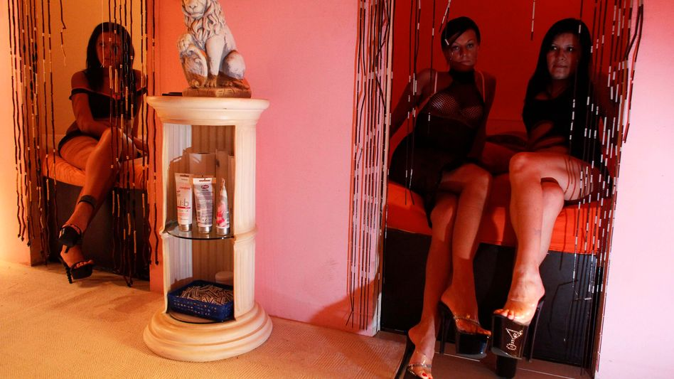Romanian prostitutes pose at a Berlin brothel in 2009.