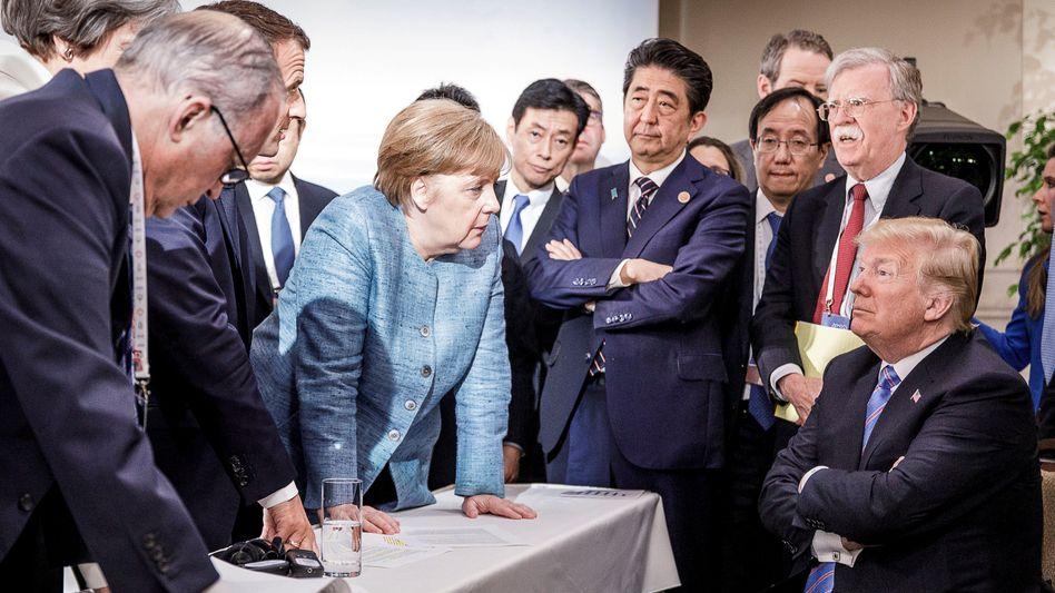 Merkel im Kreis der Mächtigen (auf dem G7-Gipfel in Quebec 2018): Die Kanzlerin hat viele Krisen eingedämmt – gelöst hat sie sie nicht