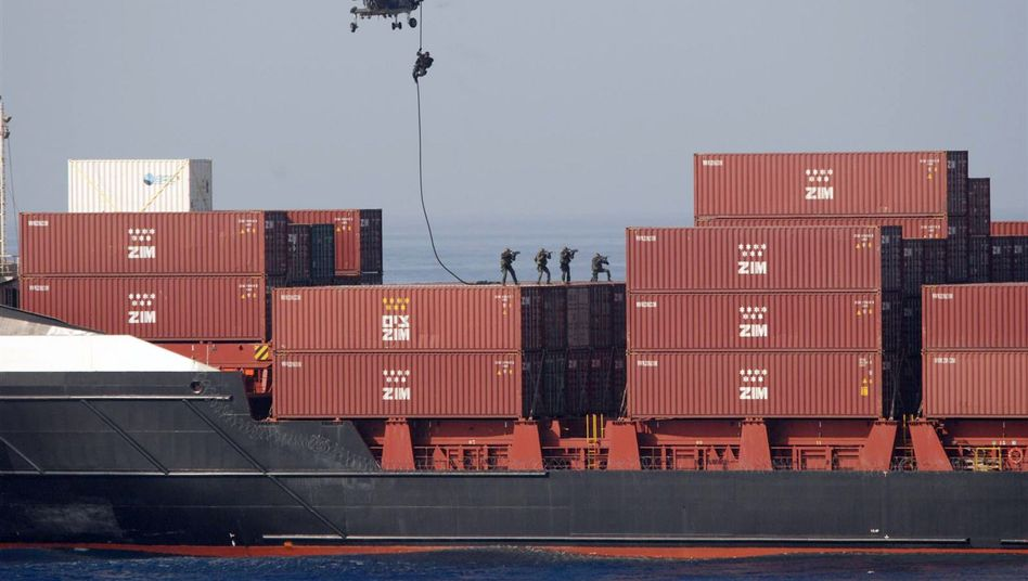 Dutch marines abseil on to the German cargo ship MS Taipan after it was hijacked off the coast of Somalia: The 10 suspected Somali pirates could face trial in Germany.
