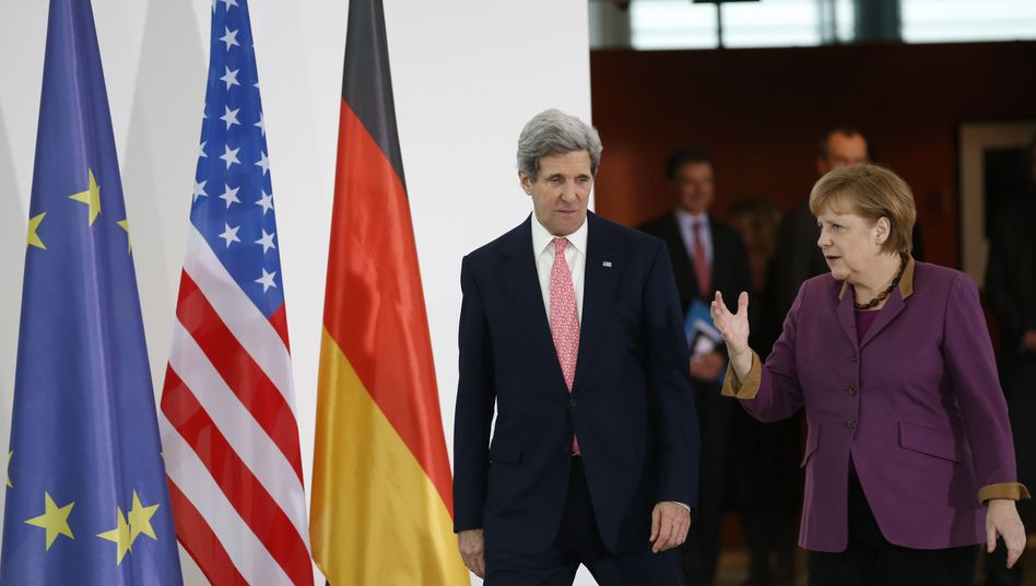 US Secretary of State John Kerry and German Chancellor Angela Merkel: America's top diplomat is hoping to smooth out trans-Atlantic relations.