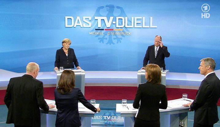 Chancellor Angela Merkel debating then-SPD chancellor candidate Peer Steinbrück in 2013