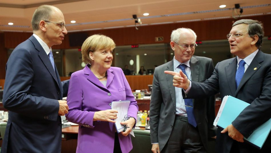 From left, Italian Prime Minister Letta, German Chancellor Merkel, European Council President Van Rompuy and European Commission President Barroso speak with each other during a round table meeting at an EU summit in Brussels.
