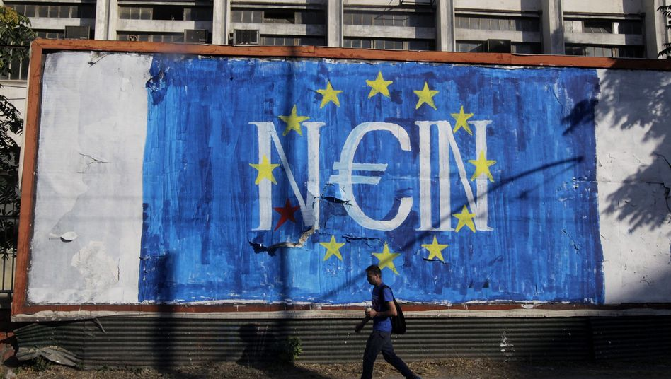 """Graffiti in Athens, Greece, depicts the euro with the word """"No"""" in German. The country closed its banks and issued capital controls on Monday."""