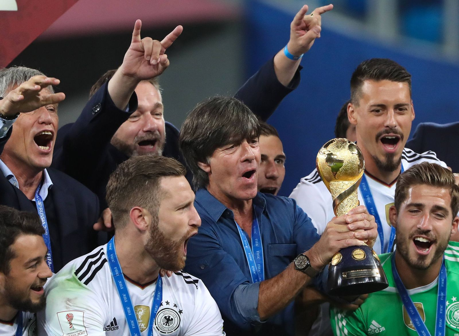 ST PETERSBURG RUSSIA – JULY 2 2017 Germany s head coach Joachim Loew C holds the trophy after w