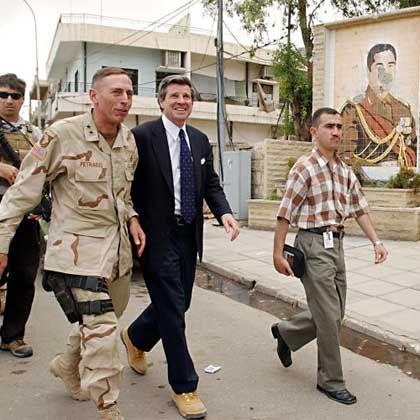 Paul Bremer (center) and David Petraeus (left) in Fallujah, Iraq in 2003.