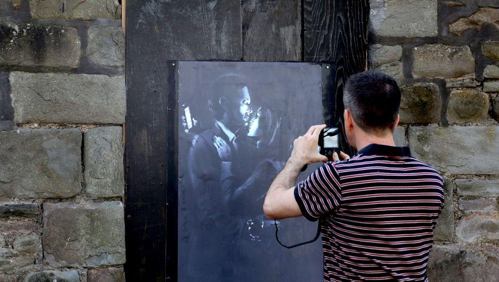 Banksy in Bristol: Bitte eine Spende. Danke