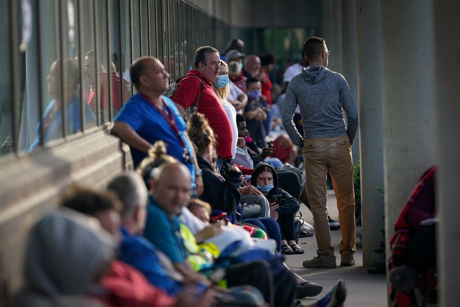 People wait outside Kentucky Career Center in Frankfort