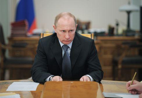 Russia's Vladimir Putin warns against military action.