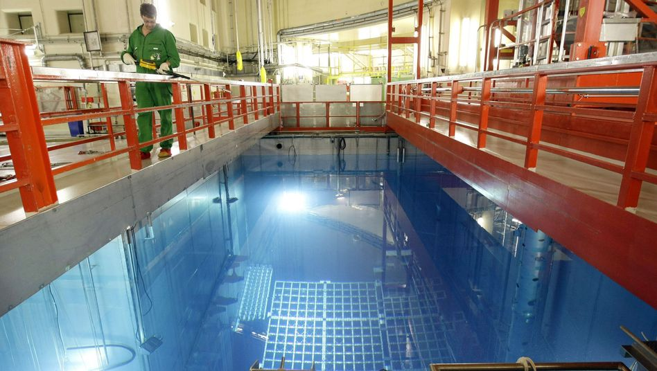 A radiation protection worker walks over a bearing basin containing nuclear fuel elements at Germany's Biblis nuclear reactor.