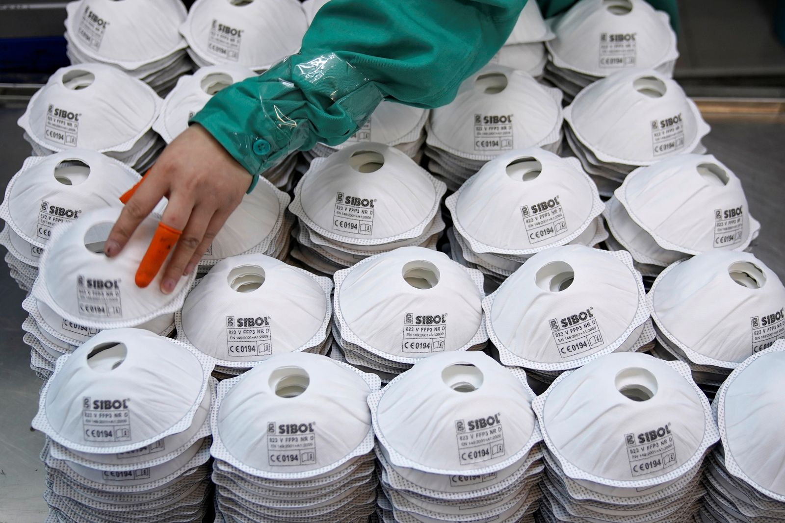 FILE PHOTO: Masks are seen on a production line manufacturing masks at a factory in Shanghai