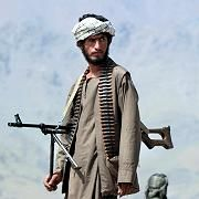 An anti-Taliban soldier outside the ex-Soviet Bagram air base in Afghanistan, September 2001.