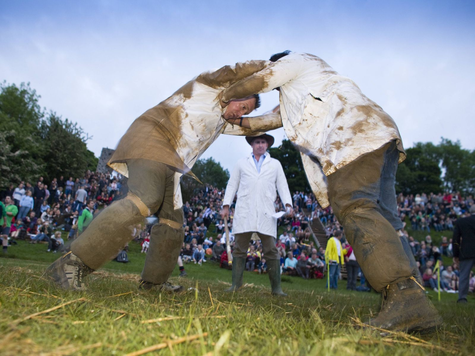 ENGLAND Men participating in a shin kicking event at the Cotswold Olimpicks Dover s Hill Glouceste