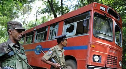 A bus destoryed by the Tamil Tigers in the Sri Lankan city of Buttala:Overstock from a global weapons bazaar
