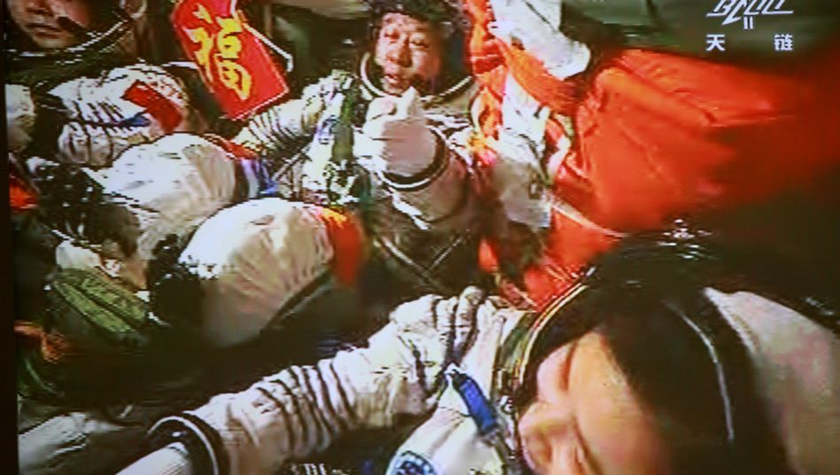 Partner or rival for Europe? Chinese astronauts can be seen as their Shenzhou-9 manned spacecraft docks with the Tiangong-1 space lab in June.