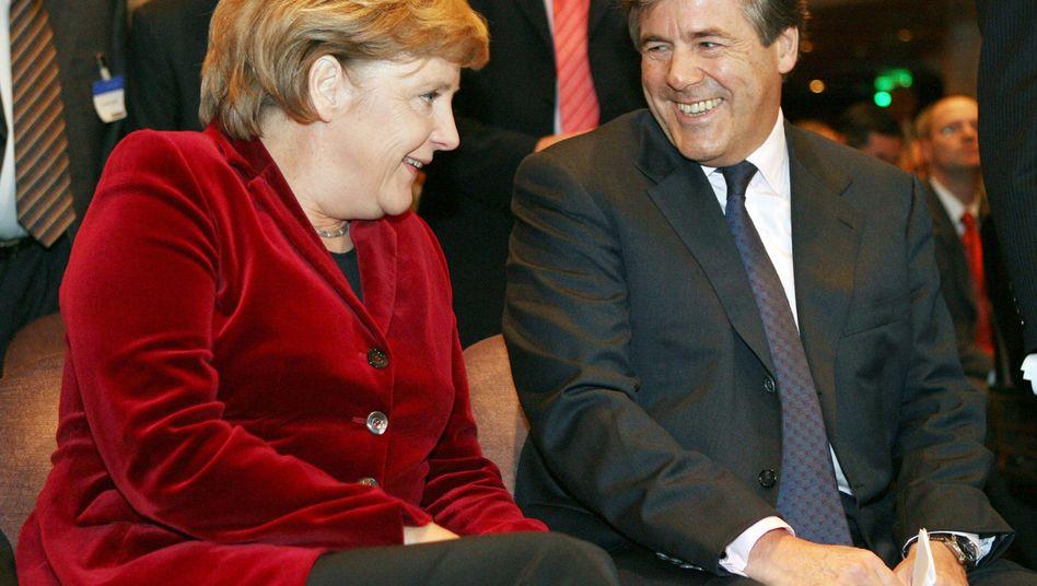 Kanzlerin Merkel, Deutsche-Bank-Chef Ackermann: Da war die Welt noch in Ordnung