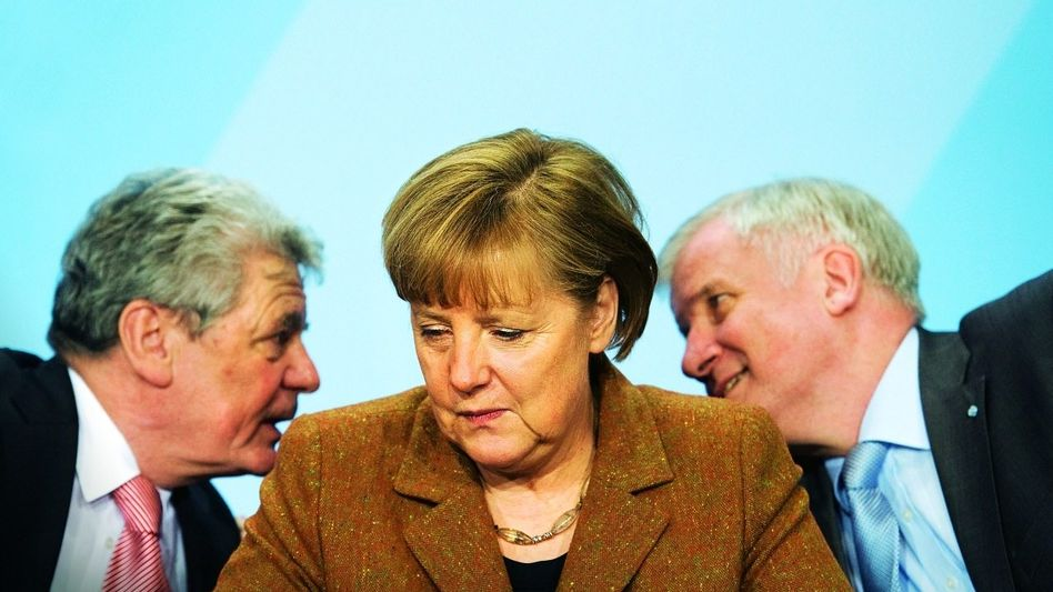 Kandidat Gauck, Kanzlerin Merkel, CSU-Chef Seehofer