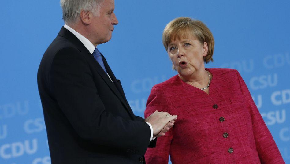Parteichefs Seehofer, Merkel: Prinzipien in Frage