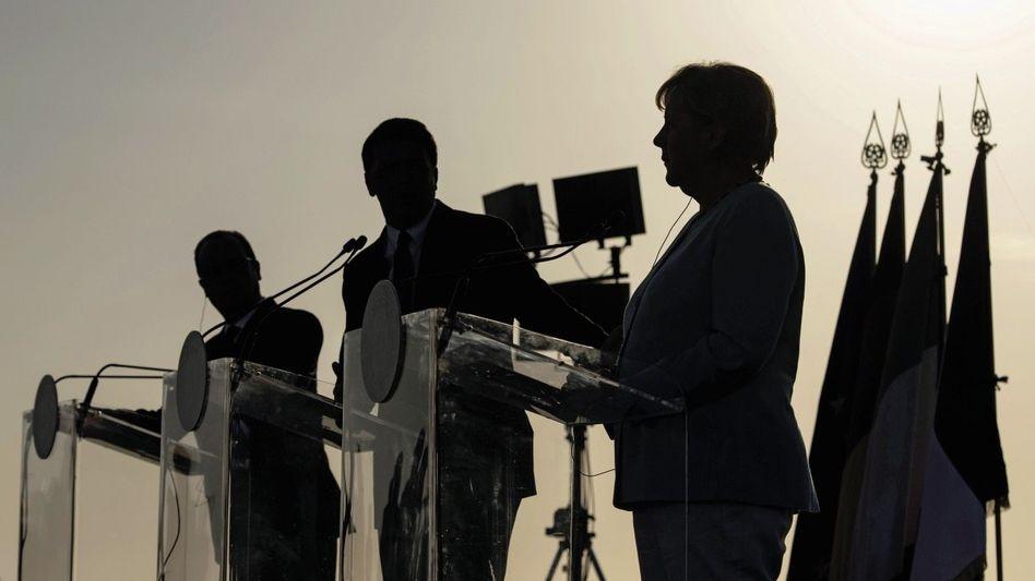 EU-Spitzenpolitiker Hollande, Renzi, Merkel(*): Defizite lockernehmen
