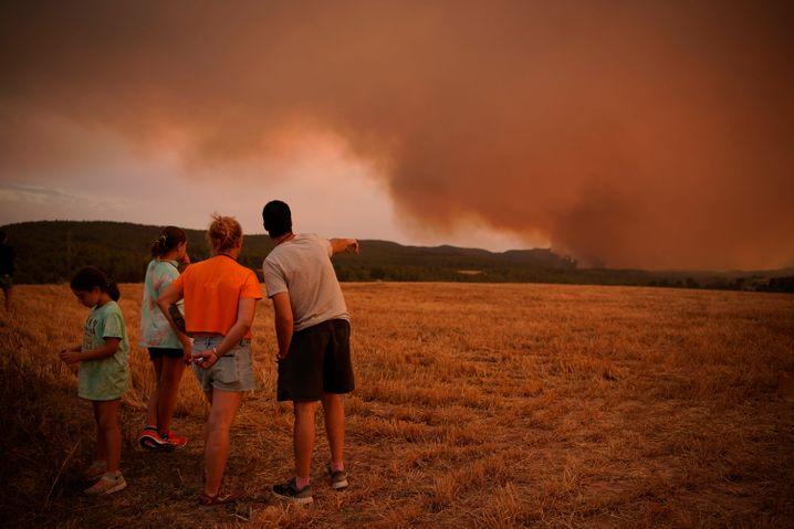Residents watching as a fire spreads near Tarragona in northeastern Spain.