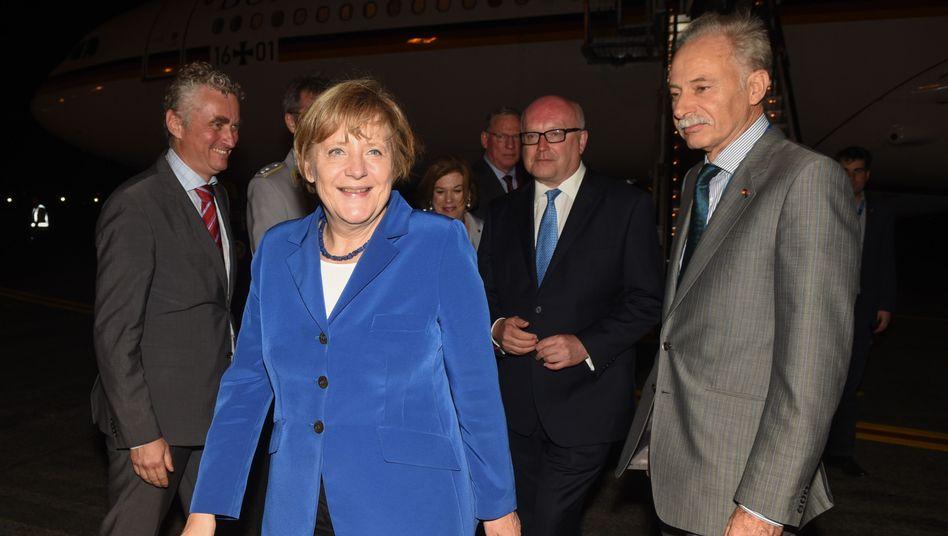 Gefeiert wie ein Popstar: Angela Merkel bei ihrer Ankunft in Brisbane