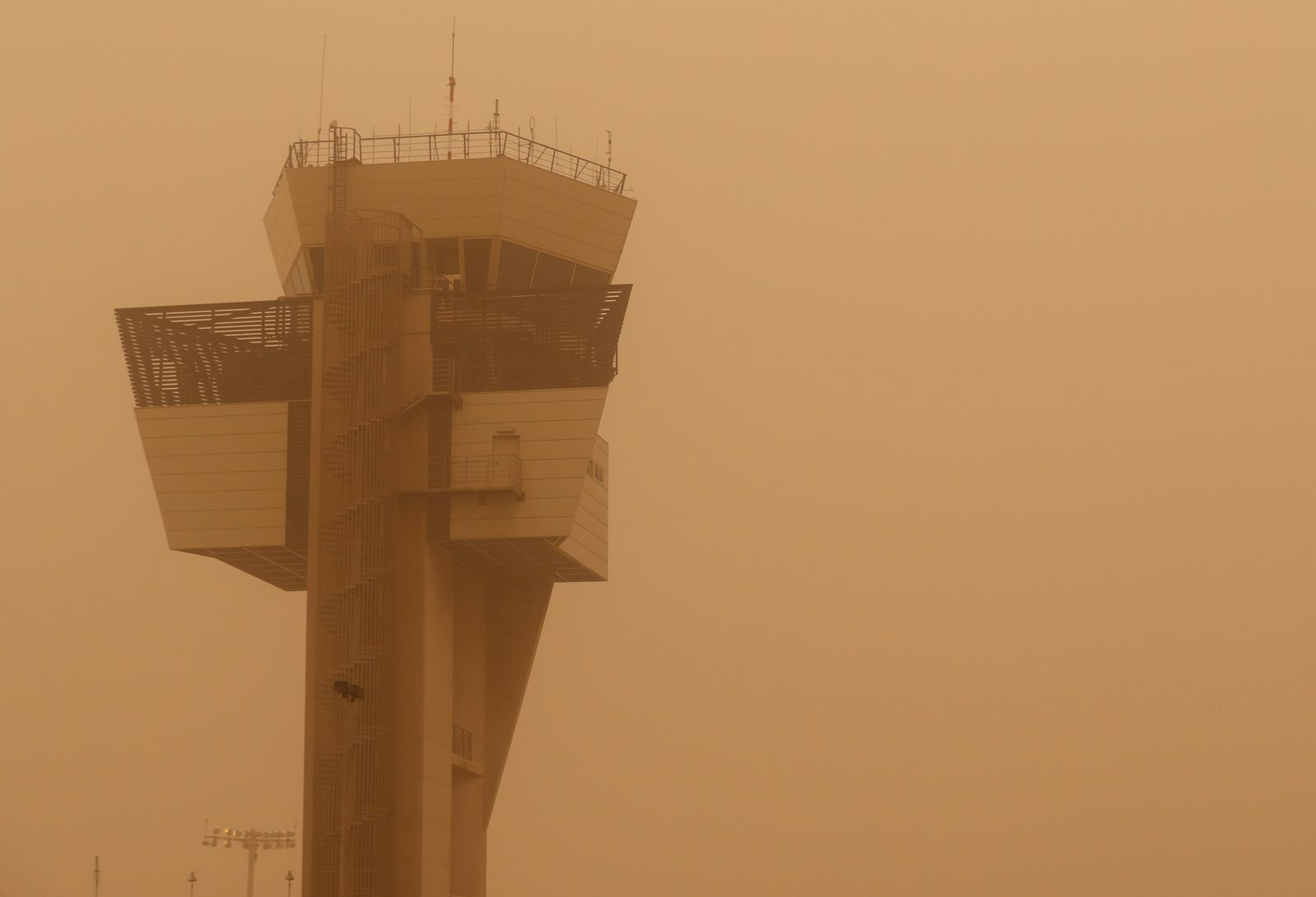 "Control tower is pictured during a sandstorm blown over from North Africa known as ""calima"" at Las Palmas Airport"