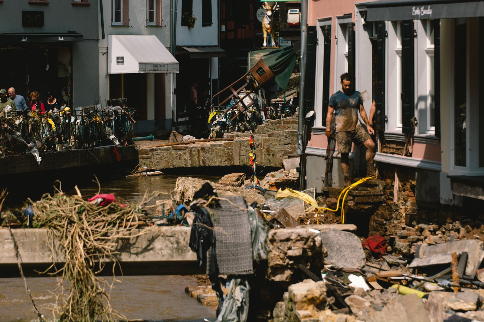 Flood In Iversheim And Bad Muenstereifel people clean up the debris in the city center of Bad Muenstereifel, Germany on