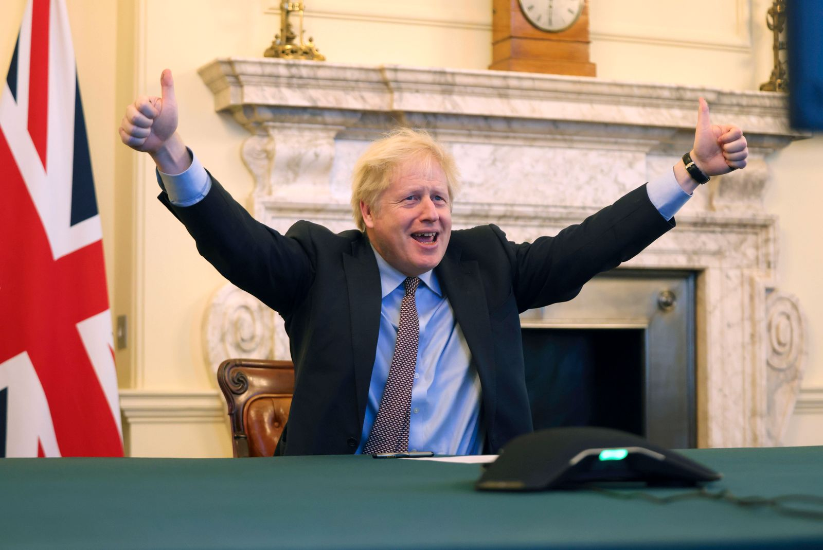 (201224) -- LONDON, Dec. 24, 2020 -- British Prime Minister Boris Johnson reacts from 10 Downing Street after Britain a