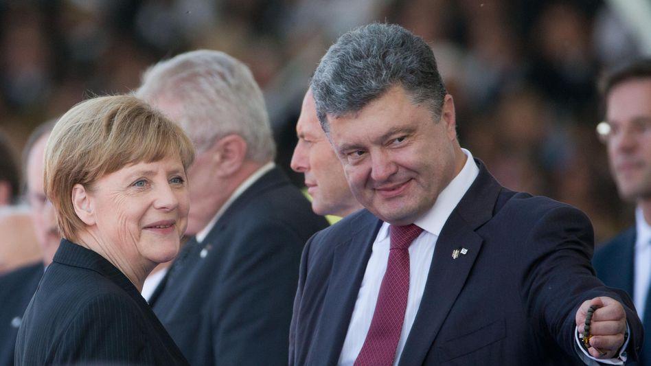 Kanzlerin Merkel und Ukraines Präsident Poroschenko: Neuer Anlauf für Frieden?