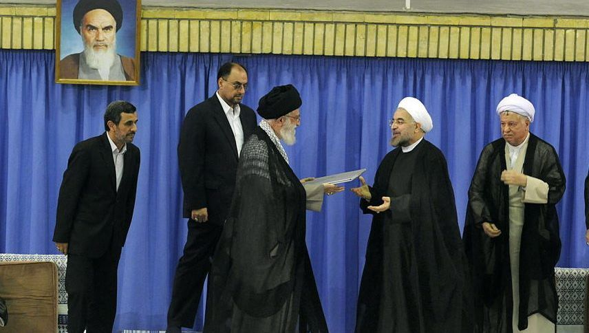 Iran's Supreme Leader Ayatollah al-Khamenei (center) gives his endorsement to newly elected President Hassan Rohani (right).