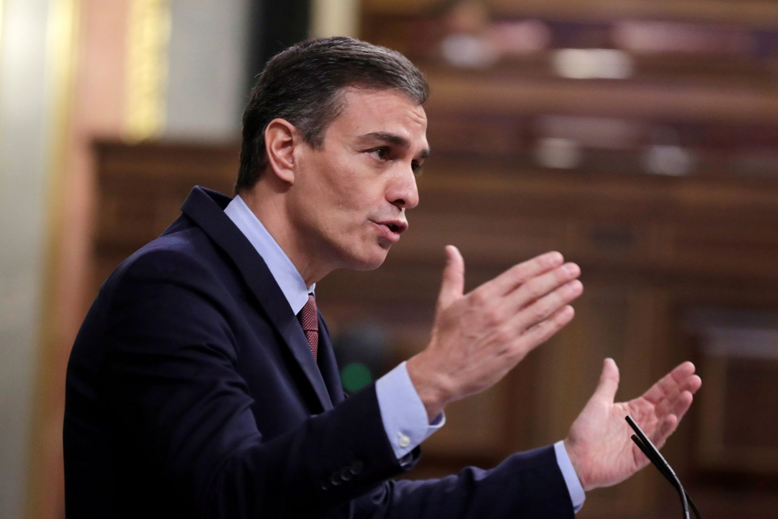 FILE PHOTO: Spain's PM Sanchez speaks during a session at Parliament in Madrid