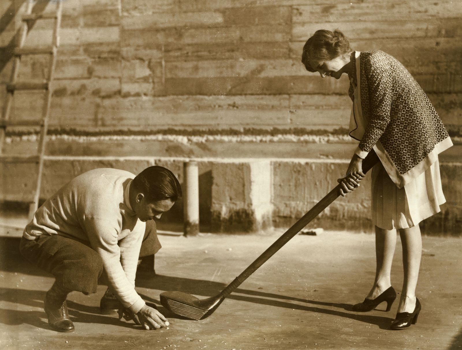 Jack Redmond - Woman Holding Large Golf Club