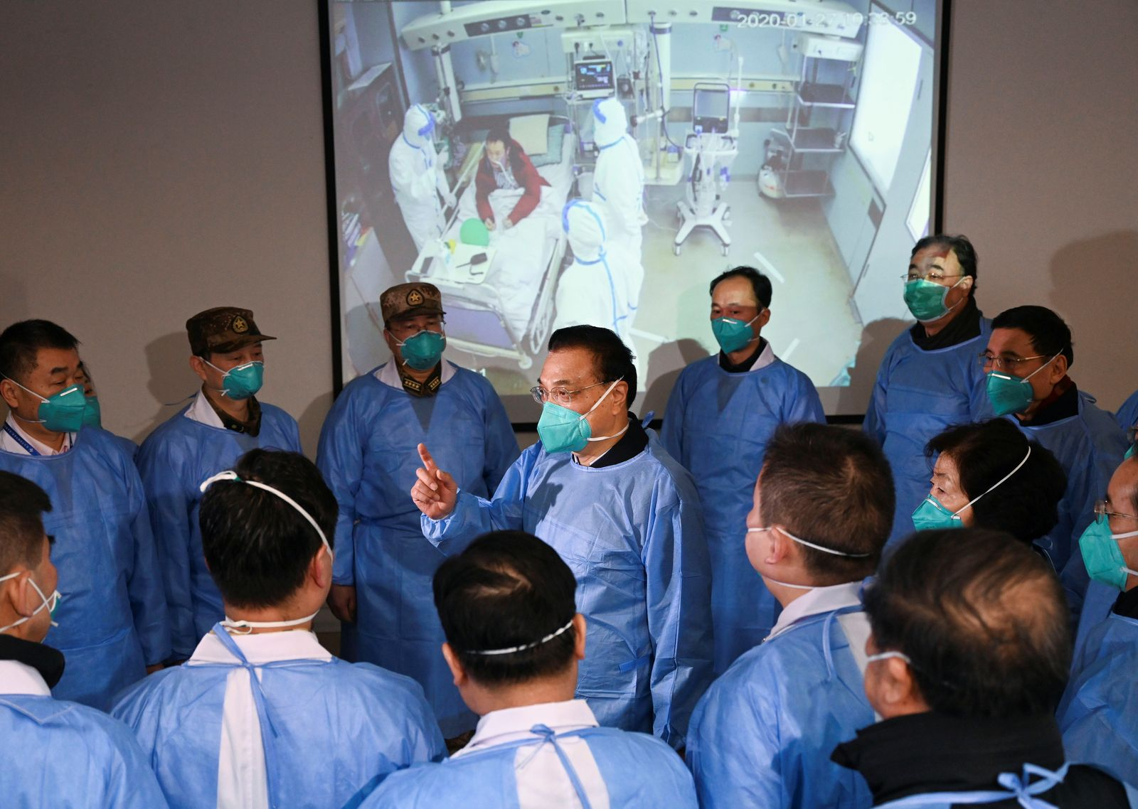 Chinese Premier Li Keqiang wearing a mask and protective suit speaks to medical workers as he visits the Jinyintan hospital where the patients of the new coronavirus are being treated following the outbreak, in Wuhan
