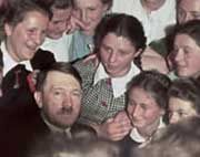 One of Hugo Jaeger's rare color photos of Hitler, here among a group of Austrian girls.