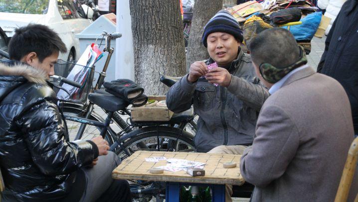 Bibbern in Peking: Mundschutz gegen die Kälte