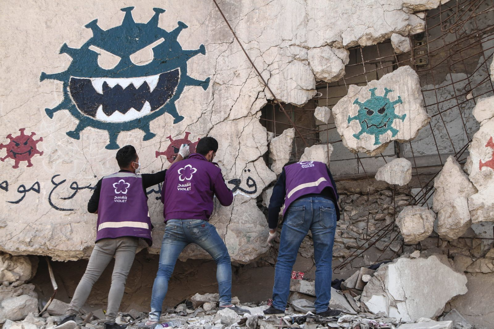 March 26, 2020: The photos show volunteers from Violet NGO drawing a painting on one of the walls destroyed by the bomb