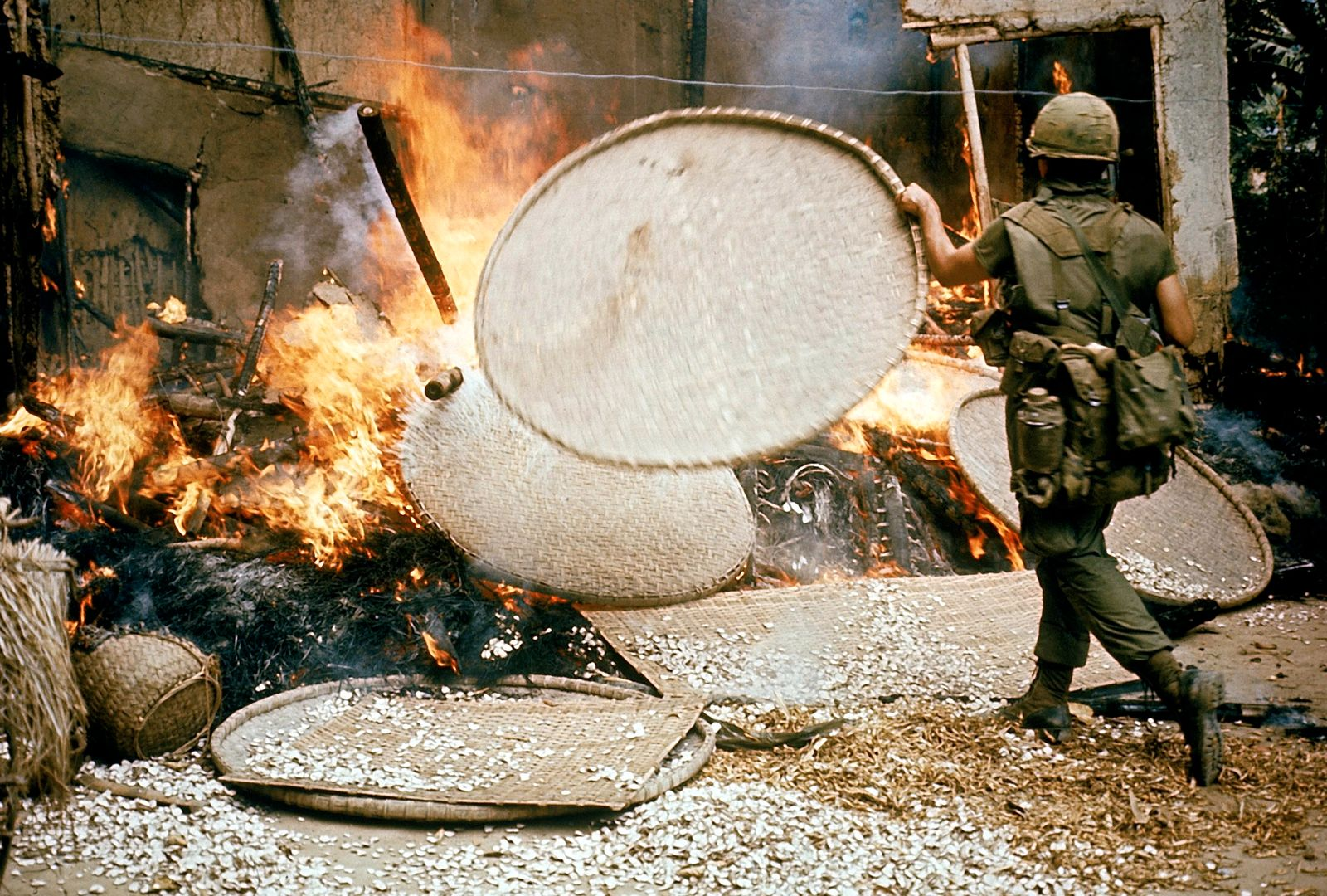 American soldier stoking fire during My Lai massacre