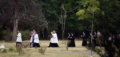 Seminarians and nuns walking in a procession at the La Reja Catholic Seminary just outside of Buenos Aires. Bishop Richard Williamson was head of the seminary until being removed over the weekend.
