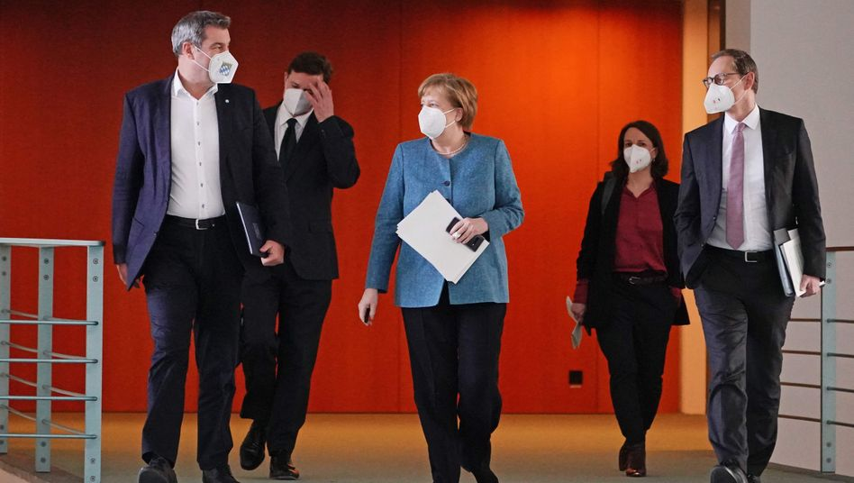 Markus Söder, Angela Merkel, Michael Müller