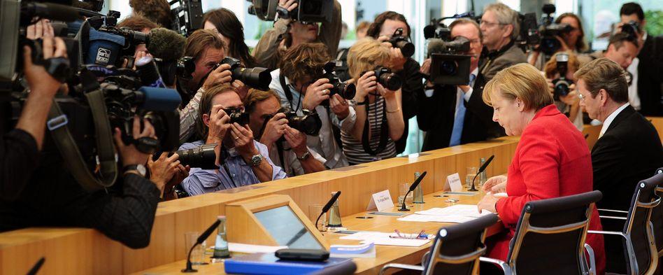 Regierungschefin Merkel, Vizekanzler Westerwelle: Der Druck auf Schwarz-Gelb wächst