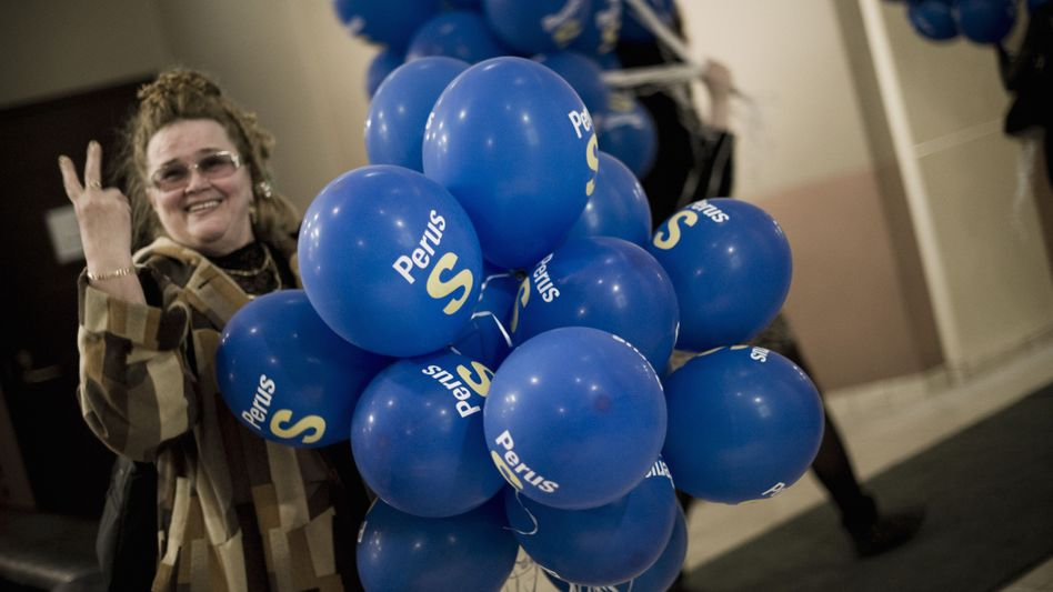 A True Finns' supporter on election night. The success of the right-wing populist party has shocked many in the European Union.